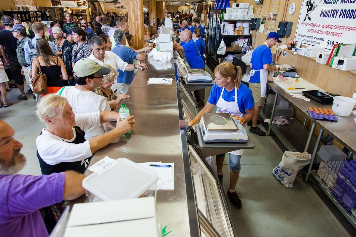 Both sides of the counter at Hilltop Acres Poultry Products.