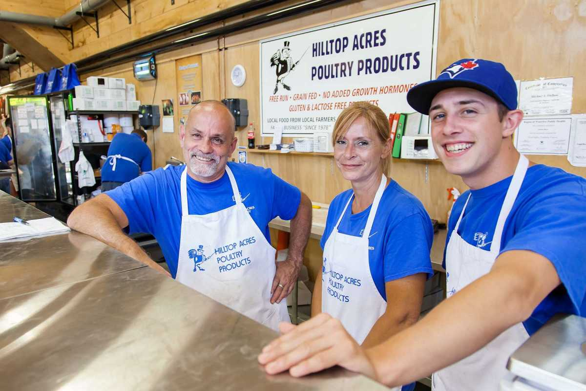 Smiling for the camera at Hilltop Acres Poultry Products.