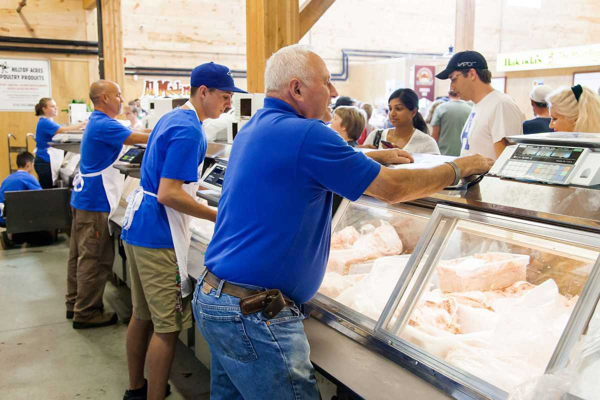 Working hard for the customers at Hilltop Acres Poultry Products.